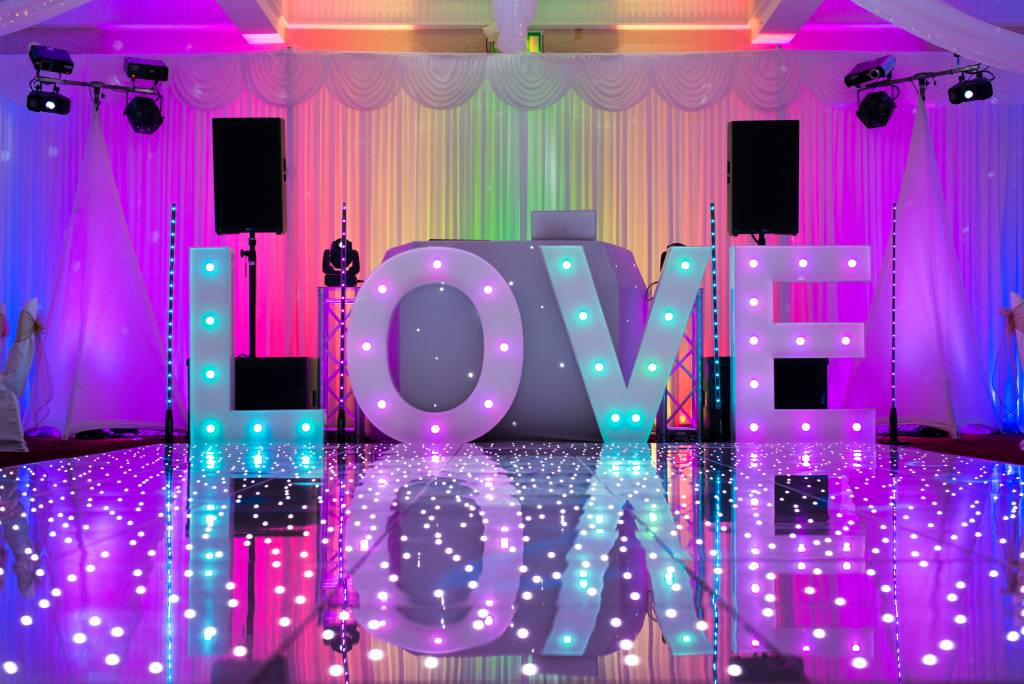 Image of light up LOVE letters on a wedding dancefloor