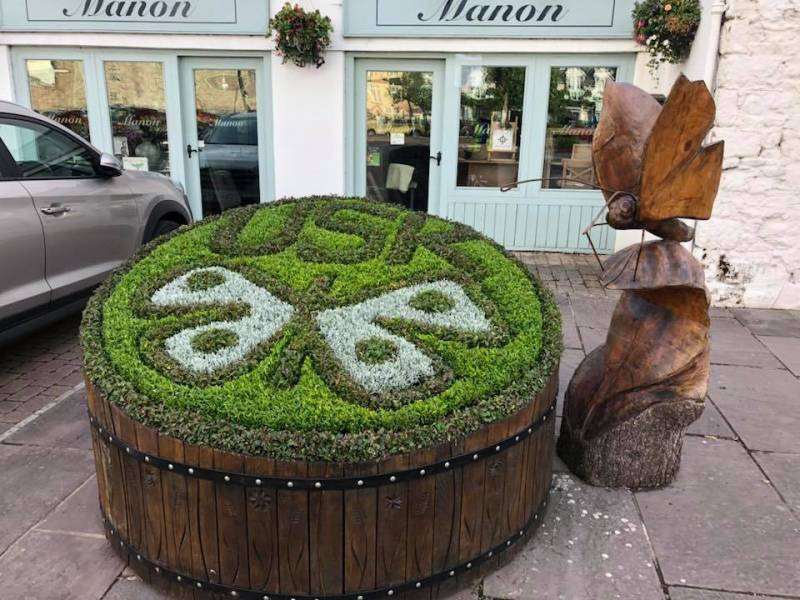 Image of one of the many (and very imaginative) planters in the town. ©  Usk in Bloom