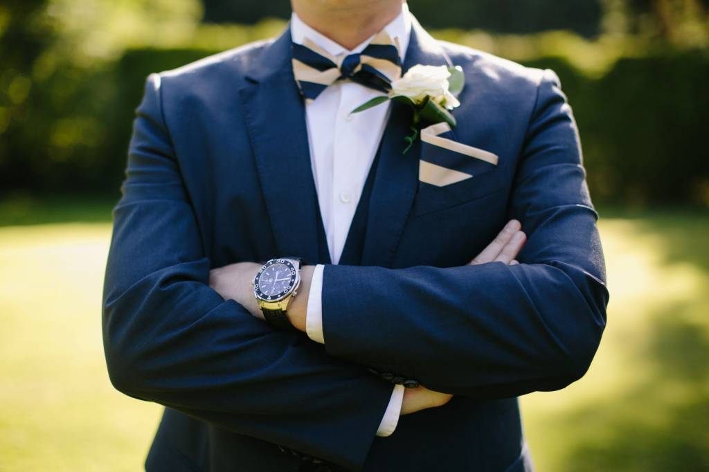 Image of a groom in a navy blue suit