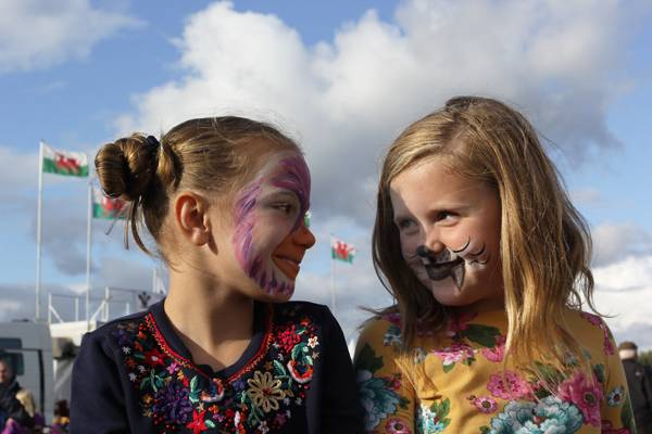 Usk Show 2017, two children enjoying a fun day after having their faces painted (above left) © Usk Show. A new Spring lamb (above right) © Crown copyright 2018 (Visit Wales).